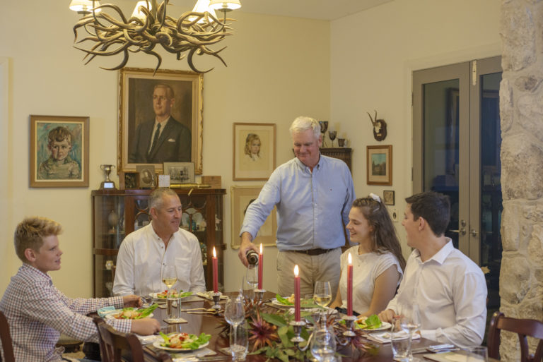 Oceanview Eco Villas guests being served a three-course dinner in the History Room of the Big House.